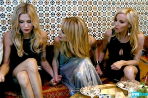 Taylor Armstrong grabs Brandi and Camille's hands and tells them to be strong women (from Bravo's photo gallery)