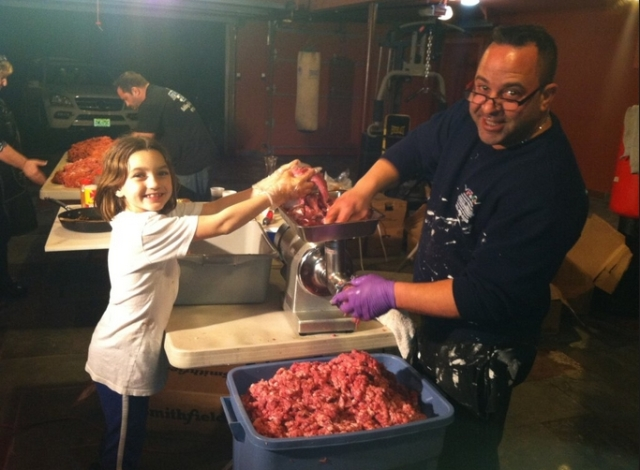 Joe Giudice and Gabriella making 800 lbs of sausage in their garage (tweet by Teresa Giudice)