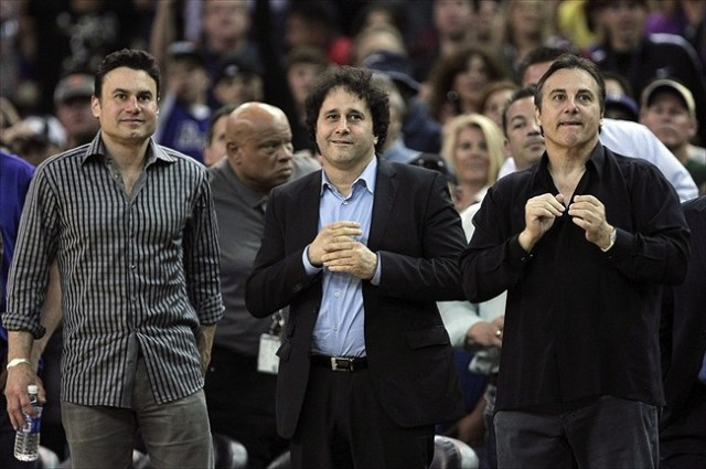 April 26, 2012; Sacramento, CA, USA; Sacramento Kings owners Phil Maloof, George Maloof and Gavin Maloof stand up after the win over the Los Angeles Lakers at Power Balance Pavilion. The Sacramento Kings defeated the Los Angeles Lakers 113-96. Mandatory Credit: Kelley L Cox-USA TODAY Sports