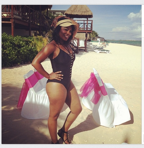 Kandi Burruss posing in front of her wedding benches at the beach - Photo Credit Kandi