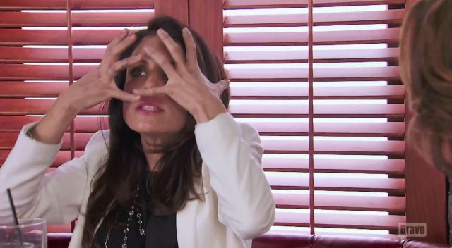 Bethenny Hands in face